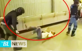 Asking the police to stop using the pepper spray, a grandma is pushed by the police with the back of her head hitting the ground